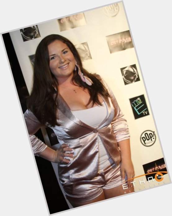 Busty latina women in sexy dress