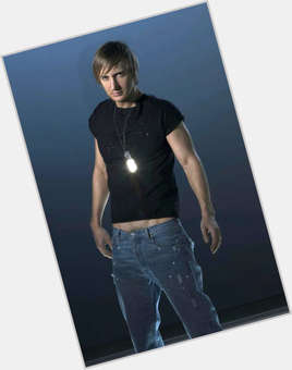 David Guetta light brown hair & hairstyles Athletic body,