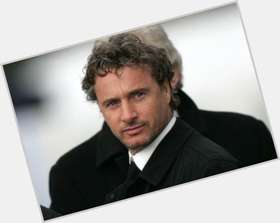 Eddie Irvine blonde hair & hairstyles Athletic body,