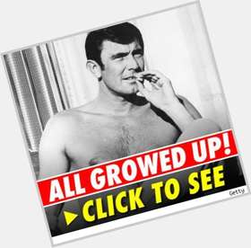 George Lazenby dark brown hair & hairstyles Athletic body,
