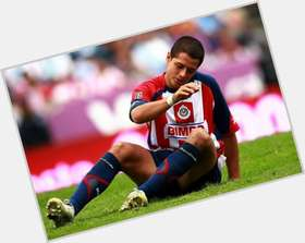 Javier Hernandez dark brown hair & hairstyles Athletic body,