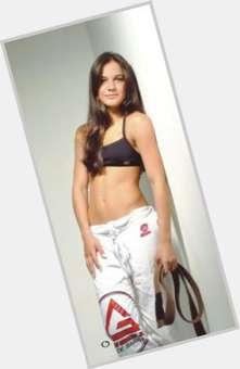"<a href=""/hot-women/kyra-gracie/is-she-married-father-boyfriend-dating-tall-hot"">Kyra Gracie</a> Athletic body,  dark brown hair & hairstyles"
