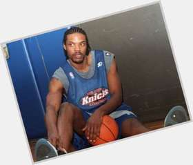 Latrell Sprewell dark brown hair & hairstyles Athletic body,