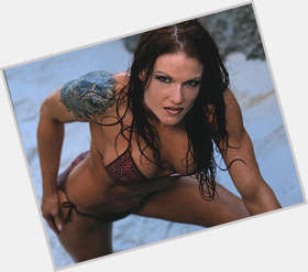 Lita dyed red hair & hairstyles Athletic body,