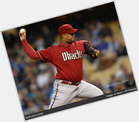Livan Hernandez dark brown hair & hairstyles Athletic body,