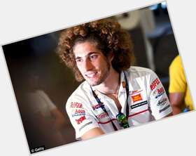 Marco Simoncelli dark brown hair & hairstyles Athletic body,