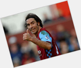 Robert Pires dark brown hair & hairstyles Athletic body,
