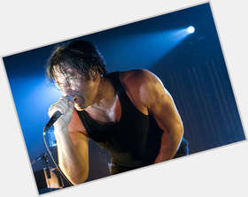 Trent Reznor dark brown hair & hairstyles Athletic body,