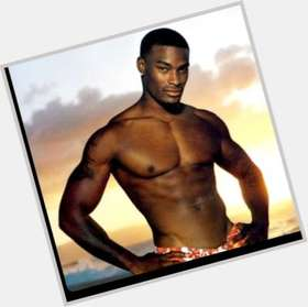 Tyson Beckford dark brown hair & hairstyles Bodybuilder body,