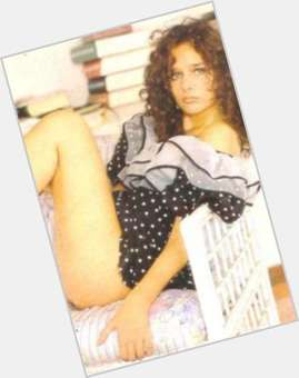 Valeria Golino dark brown hair & hairstyles Athletic body,