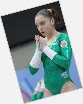 Aliya Mustafina light brown hair & hairstyles Athletic body,