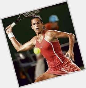 Amelie Mauresmo dark brown hair & hairstyles Athletic body,