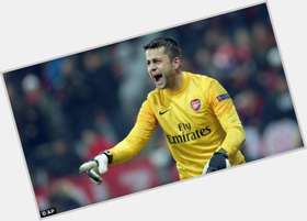 Lukasz Fabianski dark brown hair & hairstyles Athletic body,