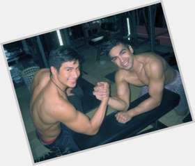 Carlos Agassi dark brown hair & hairstyles Bodybuilder body,