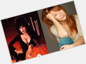 Cassandra Peterson red hair & hairstyles Average body,
