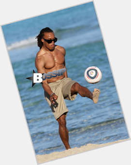 Edgar Davids dark brown hair & hairstyles Athletic body,
