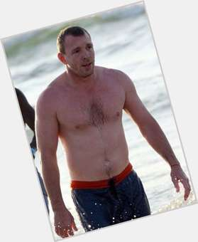Guy Ritchie light brown hair & hairstyles Athletic body,