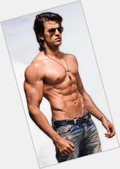 "<a href=""/hot-men/hrithik-roshan/is-he-hindu-getting-divorced-indian-vegetarian-married"">Hrithik Roshan</a> Athletic body,  dark brown hair & hairstyles"