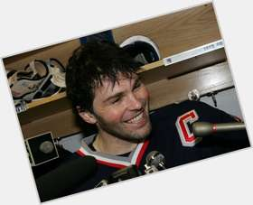 Jaromir Jagr dark brown hair & hairstyles Athletic body,