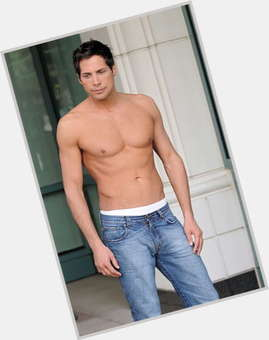Joe Francis dark brown hair & hairstyles Athletic body,