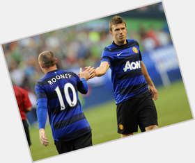 Michael Carrick dark brown hair & hairstyles Athletic body,