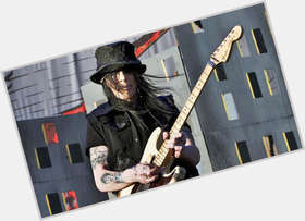 "<a href=""/hot-men/mick-mars/is-he-still-alive-left-handed-married-bald"">Mick Mars</a> Slim body,  black hair & hairstyles"