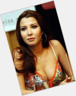 "<a href=""/hot-women/nancy-ajram/is-she-married-christian-or-muslim-still-egyptian"">Nancy Ajram</a> Slim body,  dark brown hair & hairstyles"