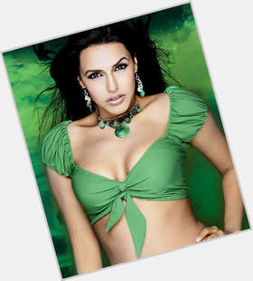 "<a href=""/hot-women/neha/is-she-dhupia-married-muslim-mehta-k-bagga"">Neha</a> Slim body,  dark brown hair & hairstyles"