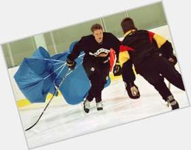 Pavel Bure blonde hair & hairstyles Athletic body,
