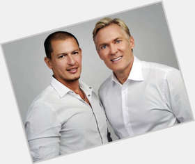 "<a href=""/hot-men/sam-champion/is-he-married-gaining-weight-vacation-still-gma"">Sam Champion</a>"