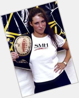 Stephanie McMahon-Helmsley dark brown hair & hairstyles Athletic body,