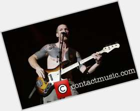Tim Commerford light brown hair & hairstyles Athletic body,