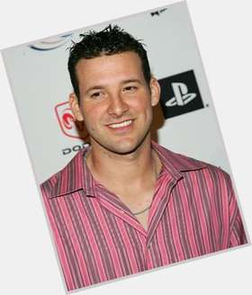 Tony Romo dark brown hair & hairstyles Athletic body,