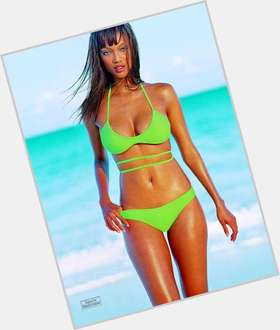Tyra Banks dyed blonde hair & hairstyles Voluptuous body,